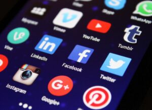 Social media apps on a mobile phone screen