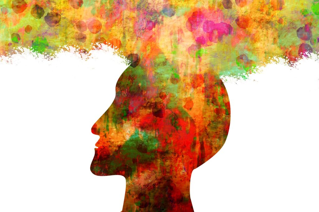 a head with many colorful thoughts
