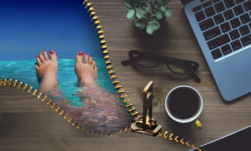 office desk with glasses, laptop, plant and a coffee and on the other side swimming in the sea, vacation